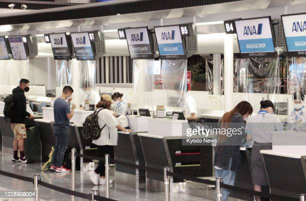 Photo taken Oct. 5 shows check-in counters of All Nippon Airways Co. At Narita airport in Chiba Prefecture. The airline resumed the same day some...