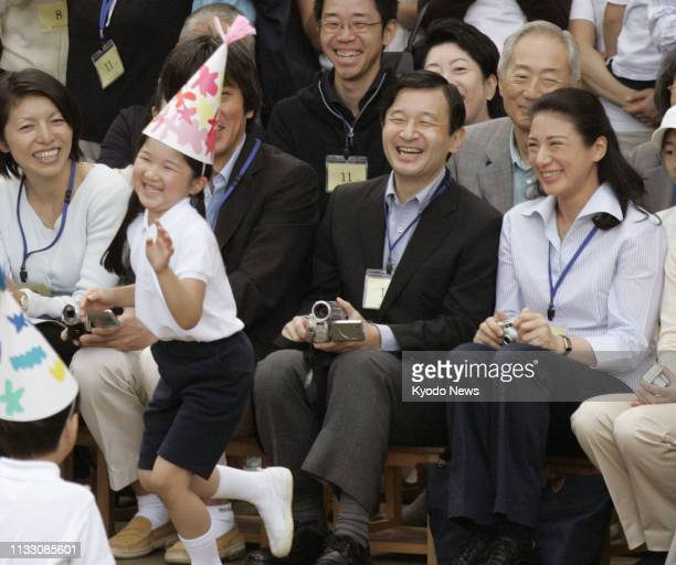 Photo taken Oct 6 shows Japanese Crown Prince Naruhito and Crown Princess Masako watching their daughter Princess Aiko during a sporting event at...