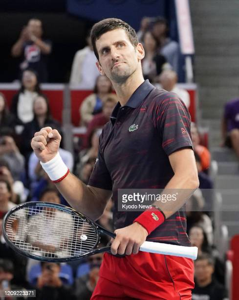 Photo taken Oct 6 shows Novak Djokovic of Serbia celebrating after defeating John Millman of Australia in the final of the Japan Open tennis...