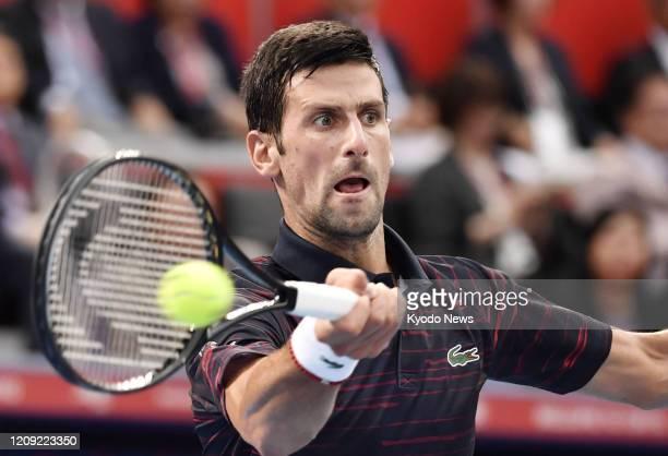 Photo taken Oct 6 shows Novak Djokovic of Serbia playing against John Millman of Australia in the final of the Japan Open tennis tournament in Tokyo