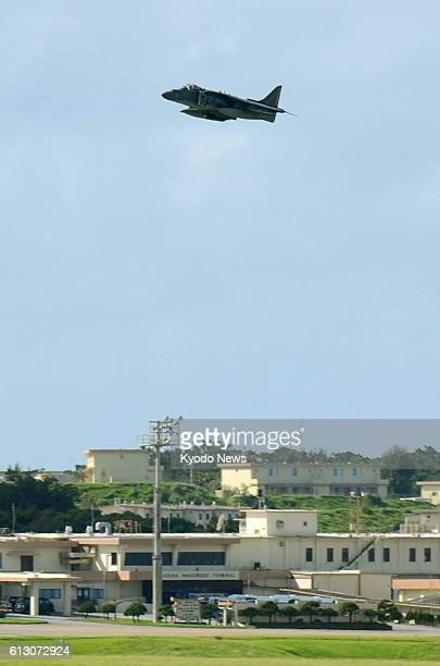 Photo taken Oct 7 shows a US Marine Corps AV8 Harrier fighter jet taking off from Kadena Air Base in Japan's southernmost island prefecture of...