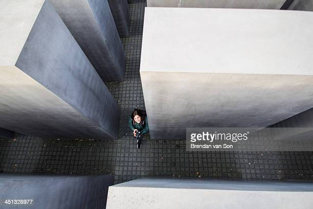 CONTENT] Photo taken of a tourist in the Memorial of the murdered Jew of Europe in Berlin Germany