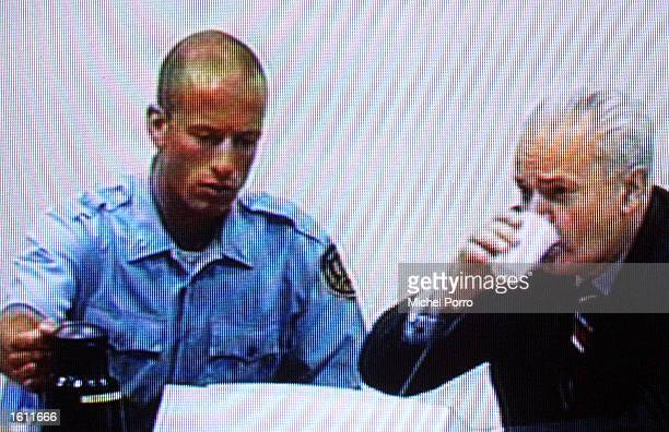 Photo taken off television showing former Yugoslav strongman Slobodan Milosevic appearing for the second time before the Yugoslav war crimes tribunal...
