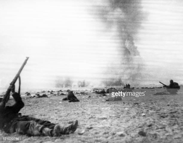 - Photo taken on 1940 shows a soldier shooting a German war plane during bombing while British and French soldiers wait on a Dunkirk beach, northern...
