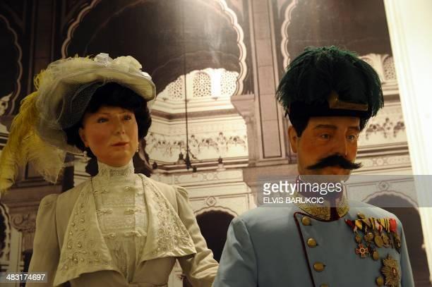 A photo taken on April 1 2014 shows the life size wax figures of Franz Ferdinand and his wife Sophie as they exit the Sarajevo Cityhall minutes...