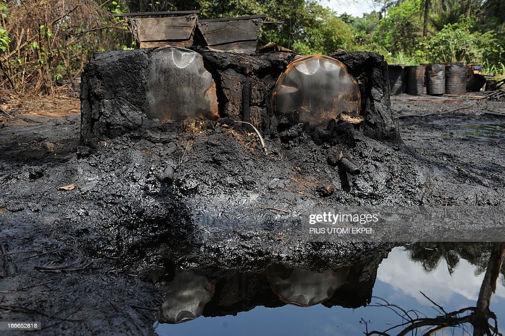 A photo taken on April 11, 2013 shows a locally built dump for crude oil waste from an illegal oil refinery operated by oil thieves in Bayelsa State in the Niger Delta. A group of men with AK-47s lay in wait for an ex-kingpin in the Nigerian swamps before instead opening fire on police -- the latest sign of trouble in a vitally important oil region. The April 5 assault in the Niger Delta killed 12 policemen, with attackers firing from a jetty before two speedboats carrying other assailants arrived and also shot at the officers, some of whom jumped in the water. The attack was yet another sign of the troubles underlying a 2009 amnesty deal in the impoverished Niger Delta aimed at ending years of unrest there. Prior to the amnesty, militants claiming to be fighting for a fairer distribution of oil revenue as well as criminal gangs had attacked oil facilities and carried out widespread kidnappings in the delta.
