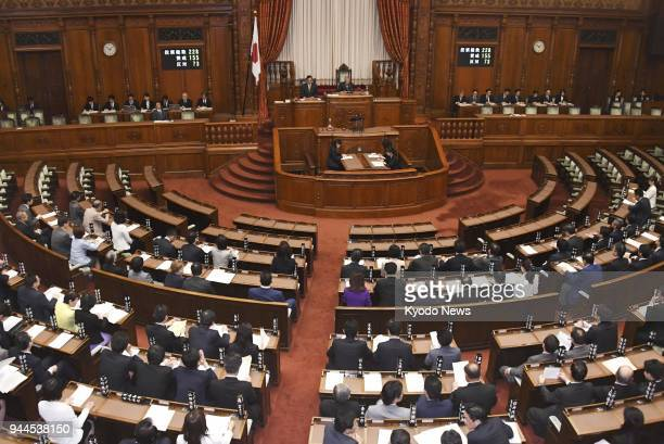 Photo taken on April 11 shows a plenary session of the Japanese parliament's House of Councillors which enacted legislation the same day to impose a...