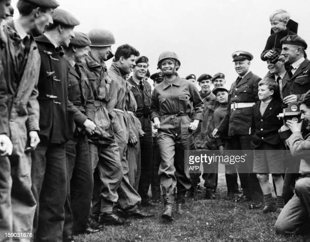 A photo taken on April 12 1959 in London shows French actress Brigitte Bardot flanked by Royal Air Force boys arriving at the RAF Base on the set of...