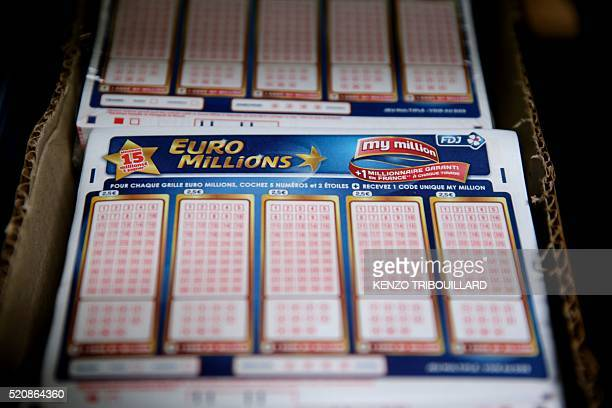 A photo taken on April 13 2016 shows a box of 'Euro Millions' lottery tickets at the new automated warehouse of Francaise Des Jeux which runs...