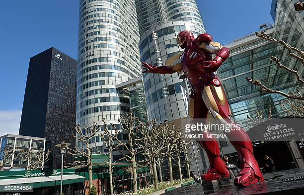 A photo taken on April 13 2016 shows a statue of Iron Man a Marvel Comics superhero outside the interactive Marvel Avengers STATION exhibition in the...