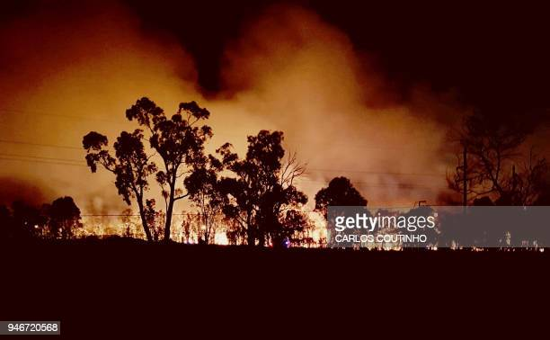 Photo taken on April 15 2018 shows a bushfire burning at Voyager Point south of Sydney Hundreds of firefighters were battling a large bushfire that...