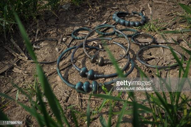 A photo taken on April 15 2019 in Tavers central France shows necklaces and bracelets dating back to the 6th century BC discovered in a field of a...