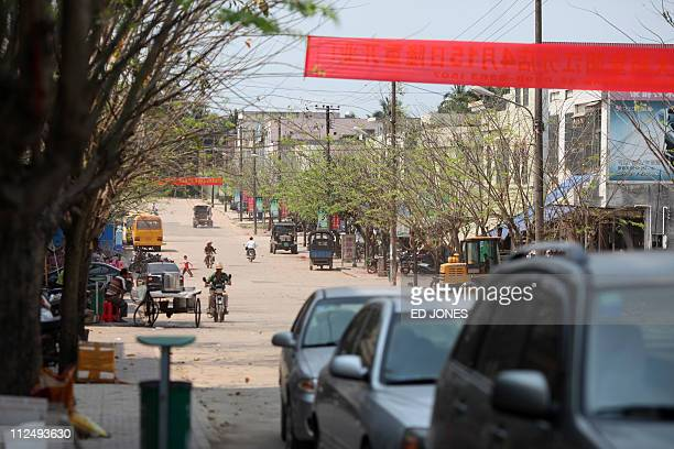 Photo taken on April 16 2011 shows a general view of a road on the outskirts of the southern Chinese city of Qionghai Hainan Tourism is a mainstay of...