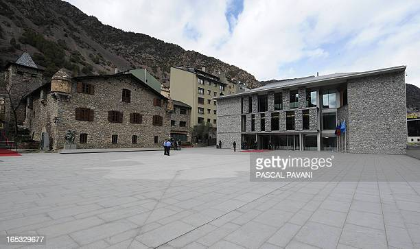A photo taken on April 2 2013 shows the old and new buildings of the General Council a unicameral parliament of the Andorra principality in Andorra...