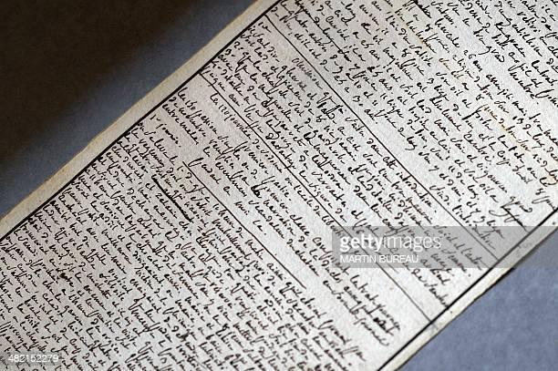 A photo taken on April 2 2014 at the Institut des Lettres et des Manuscrits de Paris shows the manuscript of The 120 Days of Sodom written by the...