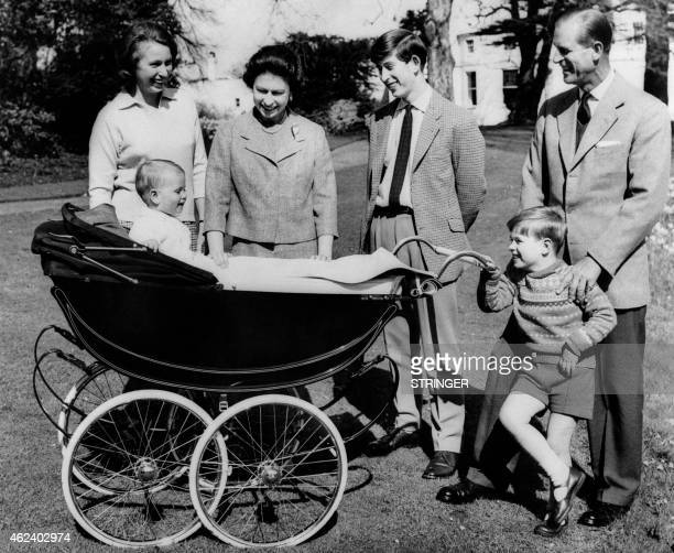 Photo taken on April 21 1965 at Frogmore House in Windsor Berkshire shows The British Royal Family Princess Anne Britain's Queen Elizabeth II Prince...