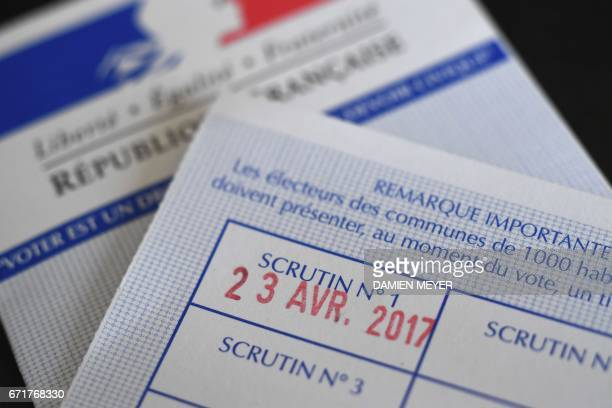 A photo taken on April 23 2017 in Rennes western France shows the date of the first round of the French presidential election stamped on a electoral...