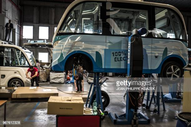 A photo taken on April 23 2018 shows on an autonomous driverless and electric bus shuttle at the NAVYA plant in Bron near Lyon central eastern France...