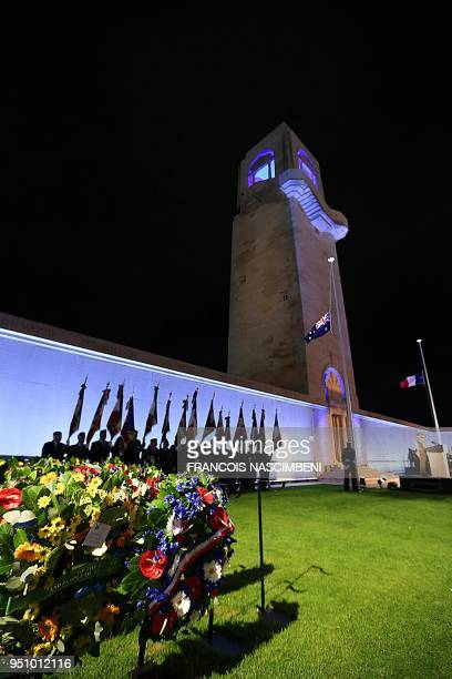 A photo taken on April 25 2018 shows French army veterans attending ceremonies marking the 100th anniversary of ANZAC Day at the Australian cemetery...