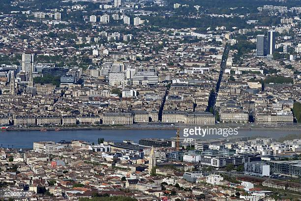 A photo taken on April 28 2016 shows an aerial view of the Garonne river and the city of Bordeaux southwestern France / AFP / EUROLUFTBILD / Robert...