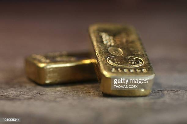 Photo taken on April 29 2010 in Paris shows two gold lingots France's credit rating is not at risk its budget minister said on April 30 after...