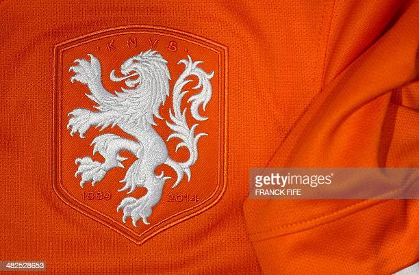A photo taken on April 3 2014 in Paris shows a partial view of the new jersey of The Netherlands' national football team AFP PHOTO / FRANCK FIFE