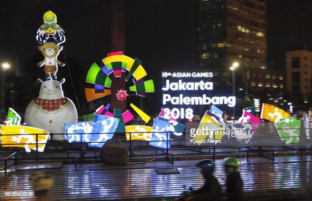 Photo taken on April 3 2018 shows neon signs promoting the upcoming Asian Games in Jakarta scheduled for Aug 18Sept 2 ==Kyodo