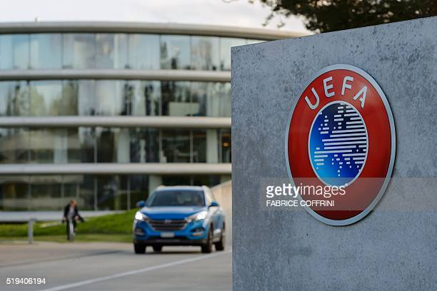 Photo taken on April 6, 2016 shows the logo of European football body UEFA at the UEFA headquarters in Nyon. Swiss police raided the headquarters of...