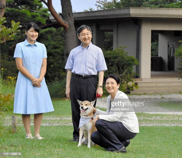 Photo taken on Aug. 25 shows Japanese Crown Prince Naruhito, Crown Princess Masako and their daughter Princess Aiko with their dog Yuri at an...