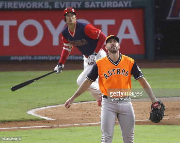 Photo taken on Aug 25 shows Los Angeles Angels designated hitter Shohei Ohtani watching his home run off Justin Verlander of the Houston Astros in...