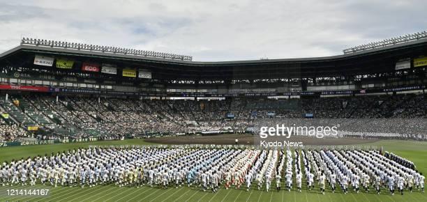 Photo taken on Aug. 6 shows the opening ceremony of the 101st National High School Baseball Championship at Koshien Stadium in Nishinomiya in Hyogo...