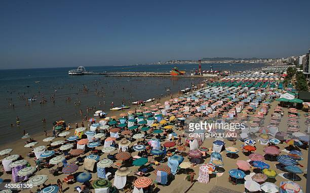 A photo taken on August 13 2014 shows a view of a crowded beach of the Albanian Adriatic Sea in the city of Durres Hot weather conditions have...