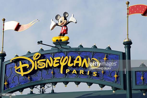 A photo taken on August 13 2015 shows a sign above the entrance at Disneyland Paris in MarnelaVallee AFP PHOTO / BERTRAND GUAY