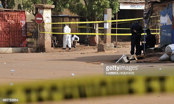 A photo taken on August 13 2015 shows police tape blocking off the site in Mali's capital Bamako where a policeman and a civilian were wounded on the...
