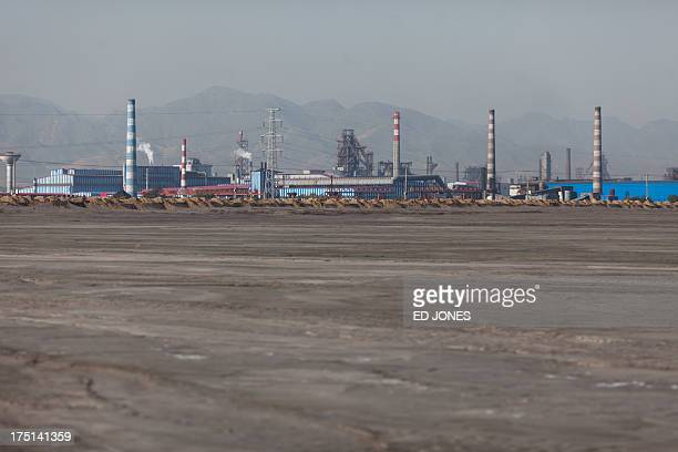 Photo taken on August 19, 2012 shows a general view of a 'toxic lake' surrounded by rare earth refineries near the inner Mongolian city of Baotou. On...
