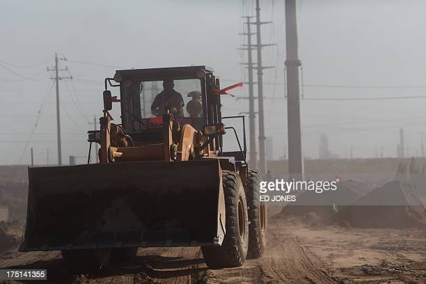 A photo taken on August 19 2012 shows a wheel loader on a road near a 'toxic lake' surrounded by rare earth refineries near the inner Mongolian city...