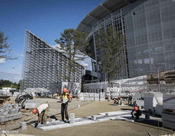 A photo taken on August 19 2017 shows the Yekaterinburg Arena football stadium under renovation work in Yekaterinburg Football fans visiting...