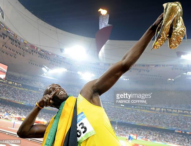"Photo taken on August 20, 2008 shows Jamaican sprinter Usain Bolt celebrating winning the men's 200m final at the ""Bird's Nest"" National Stadium..."
