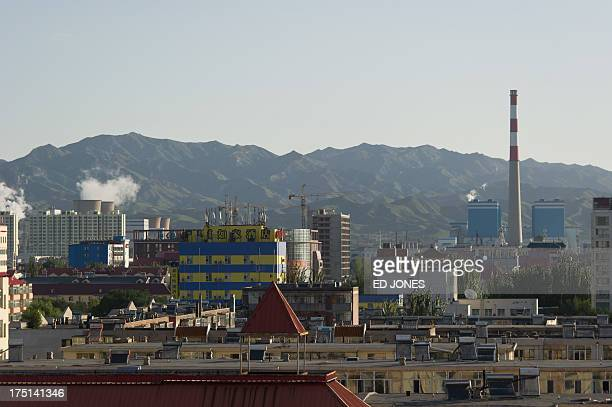 Photo taken on August 20, 2012 shows the skyline of the inner Mongolian city of Baotou. On the edge of the Chinese city of Baotou, a...