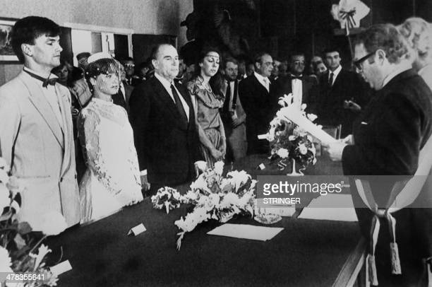 Photo taken on August 21 1982 in Puy Guillaume center France shows French President Francois Mitterrand best man of the bride listening to the speech...