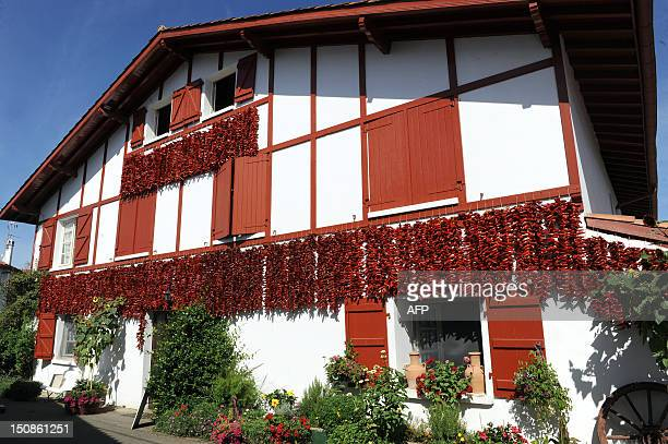 A photo taken on August 21 2012 shows chili peppers drying of the facade of a house in Espelette southwestern France IROZ