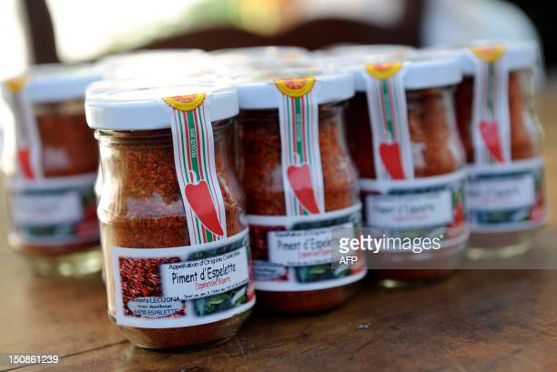 A photo taken on August 21 2012 shows jars of dried chili peppers in Espelette southwestern France IROZ
