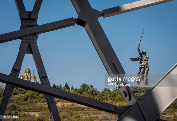 A photo taken on August 22 2017 shows the Mamayev Kurgan WWII memorial complex with The Motherland Calls statue seen trough the structure of the...