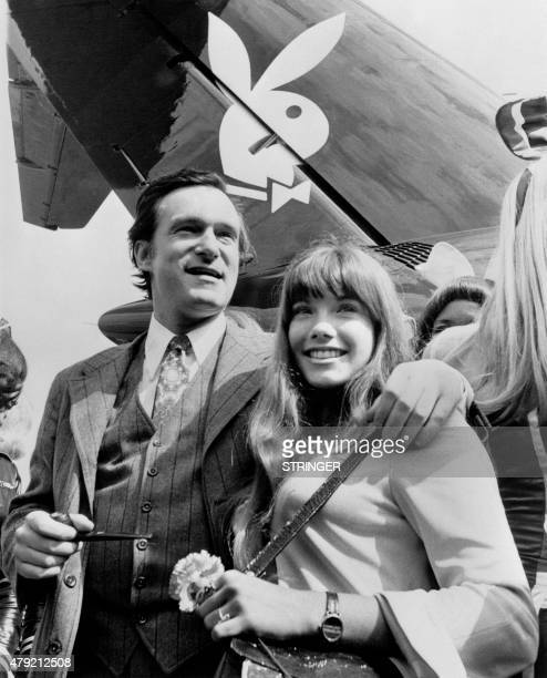 Photo taken on August 30 1970 shows US Playboy Magazine publisher Hugh Hefner and his girlfriend actress Barbara Benton arriving at Le Bourget...