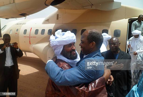 Photo taken on August 7, 2012 shows Cheick Wissa , a member of the Islamic group Ansar Dine, welcoming the foreign minister of Burkina Faso, Djibrill...