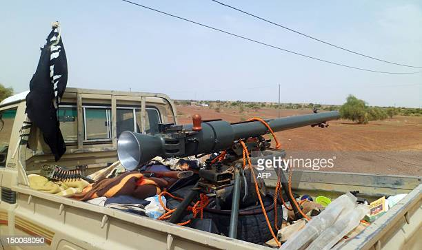 Photo taken on August 7 2012 shows the Islamic group Ansar Dine's pick up truck loaded with weapons at Kidal Airport in northern Mali Mali's...