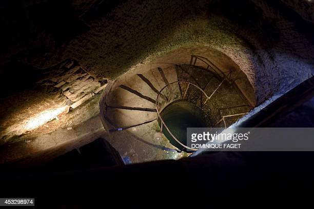 Photo taken on August 7 2014 at the Catacombs of Paris shows a view of the 'bain de pieds de carriers' a small pit containing clear water once used...
