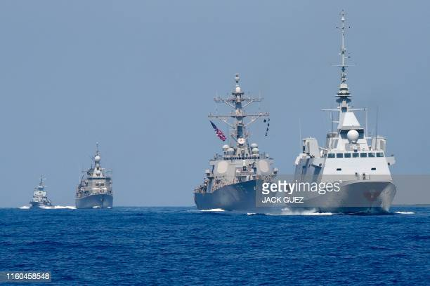 Photo taken on August 7 shows the French anti-submarine frigate FREMM Auvergne and the US Navy USS Donald Cook class guided missile destroyer and the...
