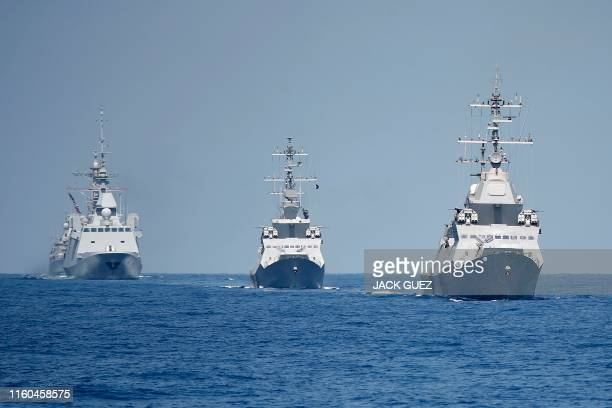 A photo taken on August 7 shows the French antisubmarine frigate FREMM Auvergne and two Israeli Sa'ar 5 class corvette during an exercise how...