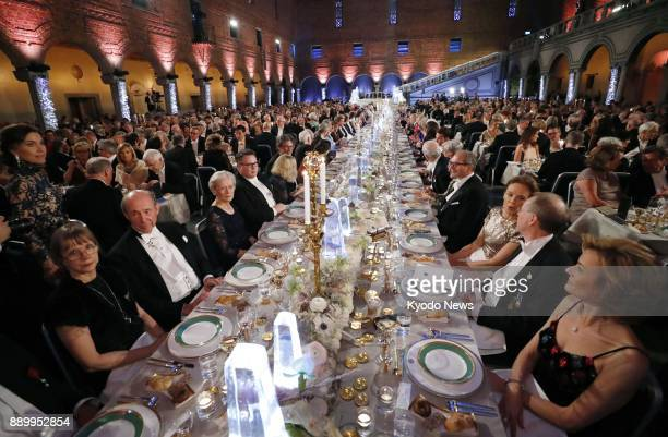 Photo taken on Dec 10 2017 shows a banquet sponsored by Sweden's King Carl XVI Gustaf for the 2017 Nobel Prize winners held at Stockholm City Hall...